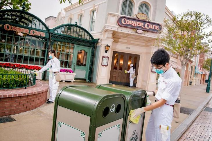 Cast Members clean park area during day time.jpeg