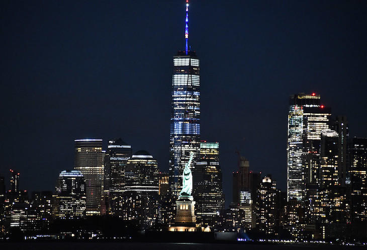 One World Trade Center, seen here with the Statue of Liberty .jpg