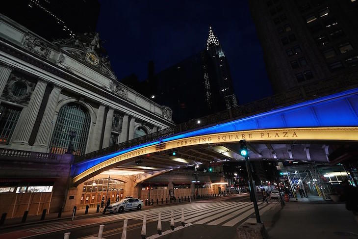 State Landmarks lit Blue and Gold in the honor of New Yorkers' work to flatten the curve of COVID-19 virus.jpg