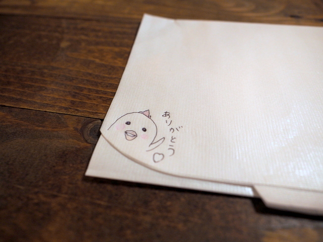 Nice hand-drawing on a paper apron to avoid getting stained by soup