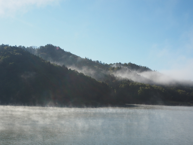 Remained mist over the lake and steam mist