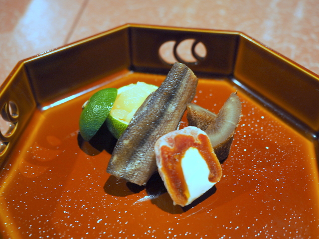 """Hashiduke hassun""(small appetizer): sake lees-pickled herring roe, flavored cooked shishamo smelt from Hiroo-cho, dried Japanese persimmon with cheese and burdock root of ""zeitaku-ni"" which literally means luxurious simmered dish"