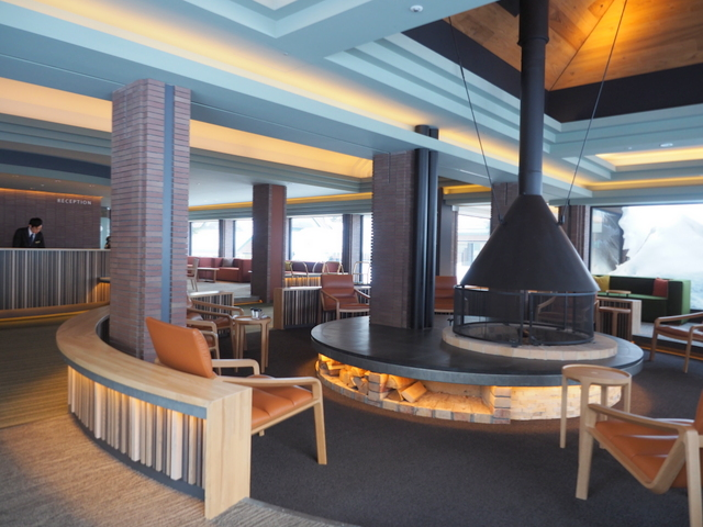 Lobby with a wood stove of Resonare Tomamu