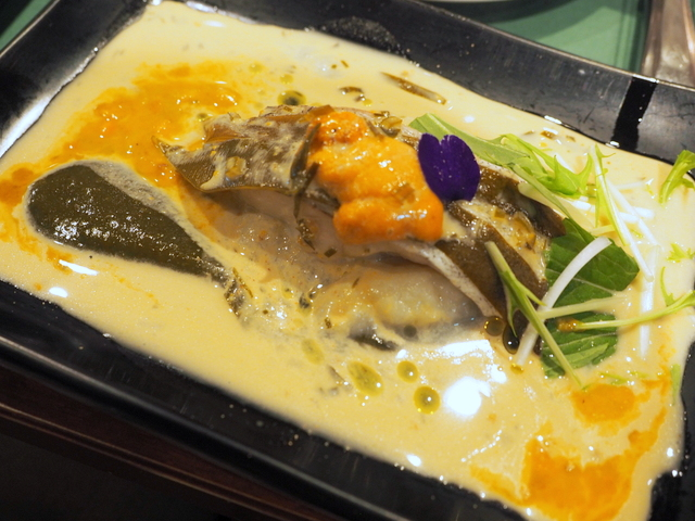 Steemed codfish and kelp from Rausu with sauce of sea arch,kelp soup and white wine
