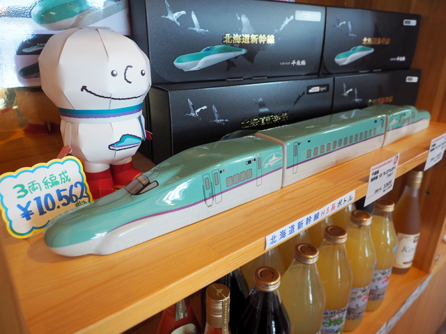 """Sake in the festive premium bottles for the Hokkaido Shinkansen's First Operation"" at the ""Cafe and Bakery Shop"" in Yoichi Winery"
