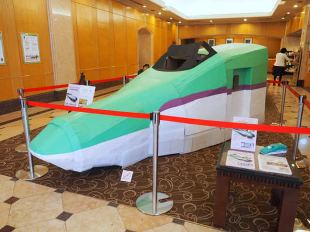 3D model of Hokkaido Shinkansen which was created by the cardboard artist, Suguru Yoshida, in the lobby of Century Royal Hotel