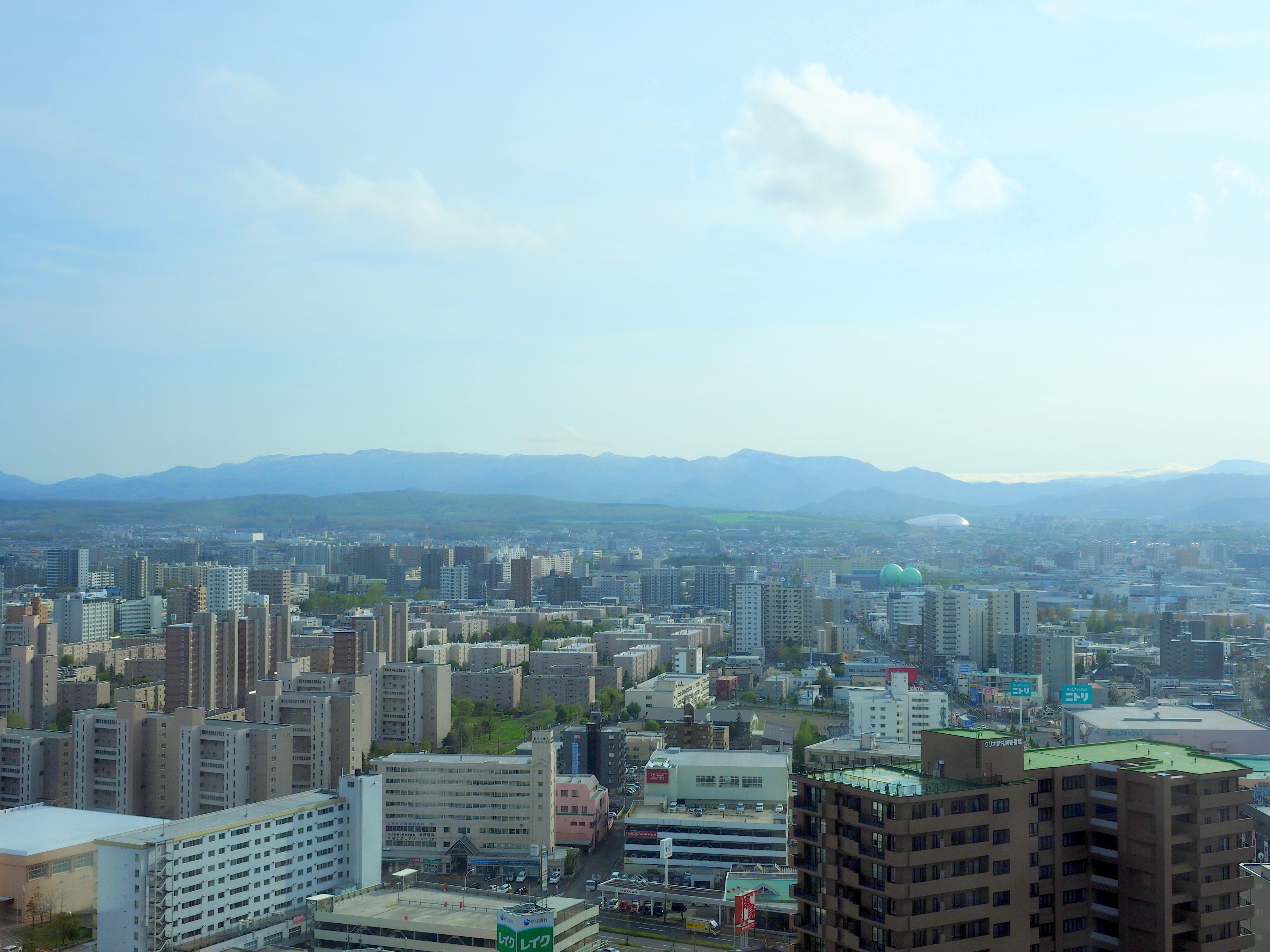 View of the range of mountains at the western area of Sapporo and Sapporo Dome