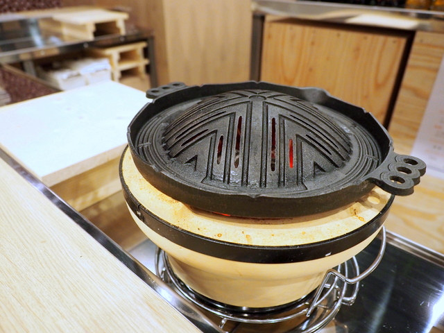 Perforated pan in the style of a pot for Jingisukan on the charcoal stove