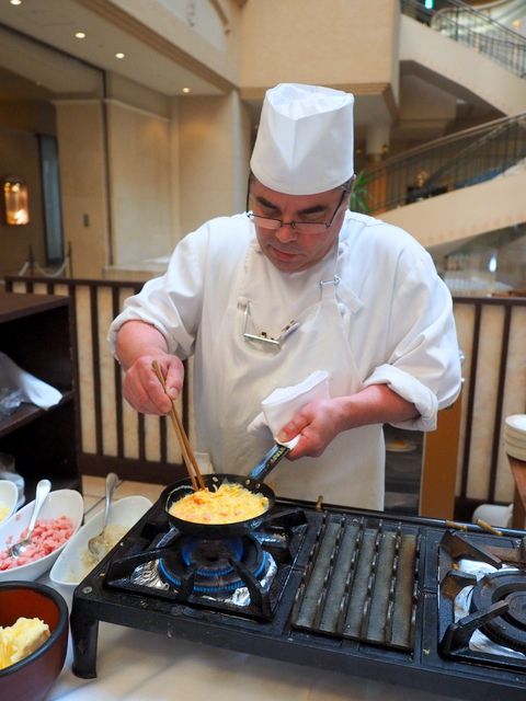 Chef from France makes omelettes for customers