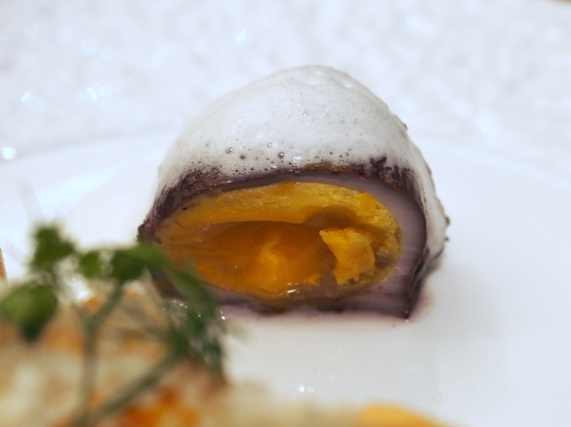 Boiled egg seasoned with red wine